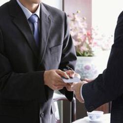 men exchanging cards